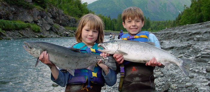 Kids enjoy fishing for silver salmon in Bird Creek, Alaska