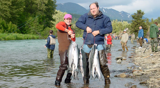 A couple with fresh sockeye salmon from the Russian River, Alaska
