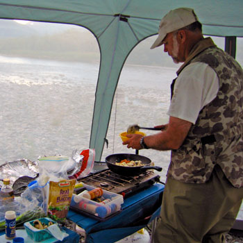 Cooking breakfast on the river, Alaska