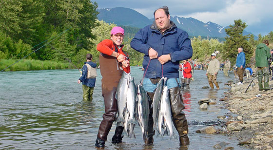 couple holding up two limits of sockeye salmon on the Russian River, Alaska