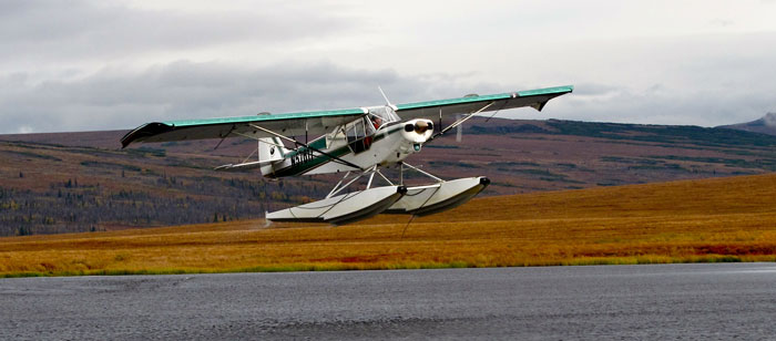 Flying out of a remote Alaska river on a float hunt for moose