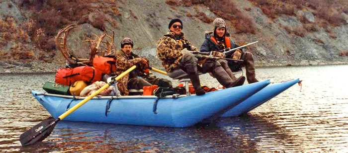Paul Jobe, Neil McMahon and Brad Garness on a float hunting trip on Alaska's Noatak River in 1989.