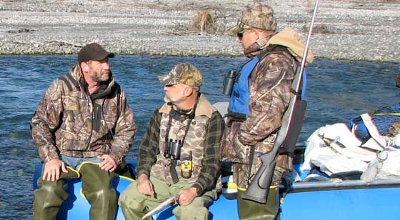 Hunters planning the day on an Alaska river