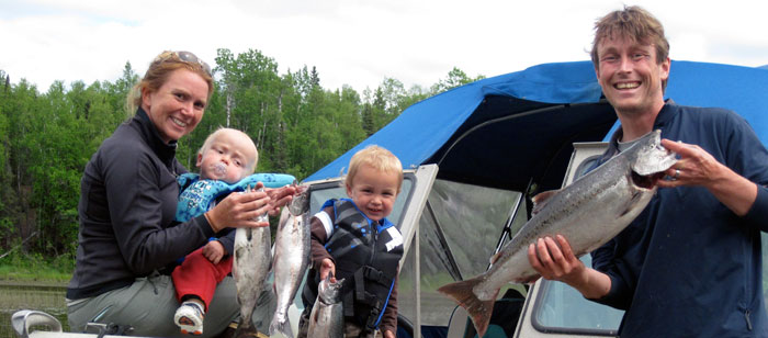 The Mason family fishing pink salmon on an Alaska river