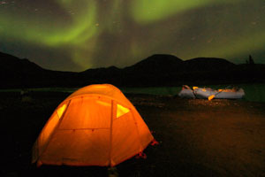 Camping in Alaska under the northern lights